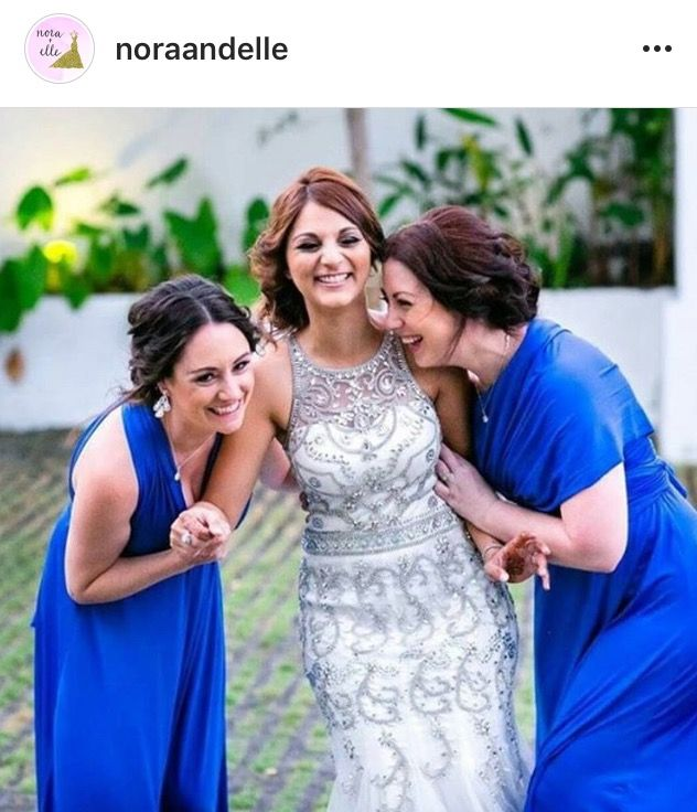 Cobalt Blue Convertible Gowns. Amazing against our beautiful brides dress. Style to suit everyone. Available at Nora and Elle.