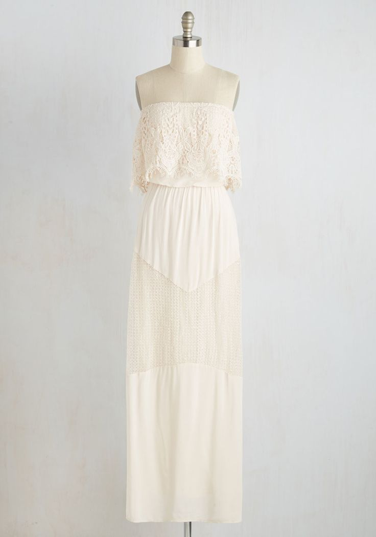 "ModCloth ""Pop Over Anytime! Dress"" $74.99.  This 1970s style wedding dress would be just perfect for a laid back or retro wedding.  Just don't go popping outta your dress ... ya wha!?"