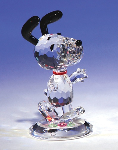 "The ""Dancing Snoopy"" crystal figurine is meticulously crafted from hand-cut and polished crystal prisms. PEANUTS (C) 2011 PEANUTS Worldwide LLC. www.CrystalWorld.com"