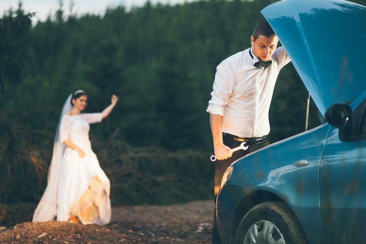 Groom is fixing car while bride is hitchhiking.