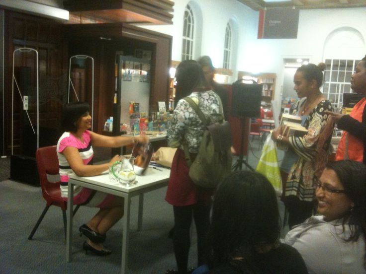 "Nalini makes her fans extremely happy by autographing piles of books at the ""An Evening With Nalini Singh"" event, Remuera Library, 5 Nov 14"