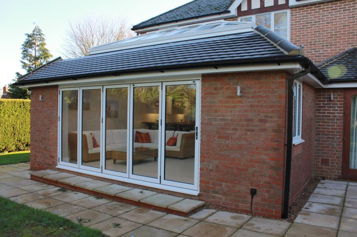 External view of roof lantern and white frame bifold doors