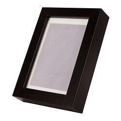 Fotolijst, waar de foto's inkomen naast grote spiegel met zelfde lijst
