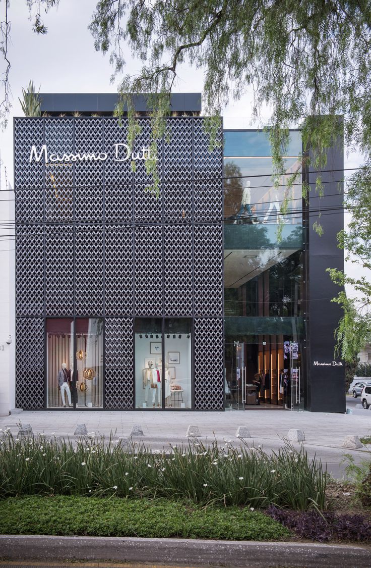 Dark metallic screen covers massimo dutti store in mexico city by sma