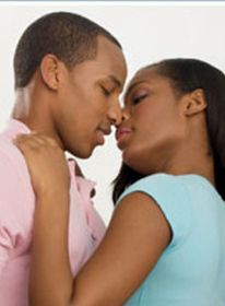 With love. An Afro-American couple kissing