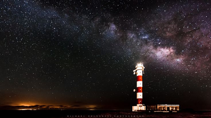 The summer Milky Way over the lighthouse in Poris de Abona, Tenerife. The glowing light to the bottom left is the light pollution from Las Palmas de Gran Canaria.This is a single exposure.