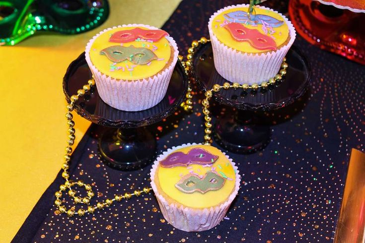 Fun cupcakes at a  Mardi Gras party! See more party planning ideas at CatchMyParty.com!
