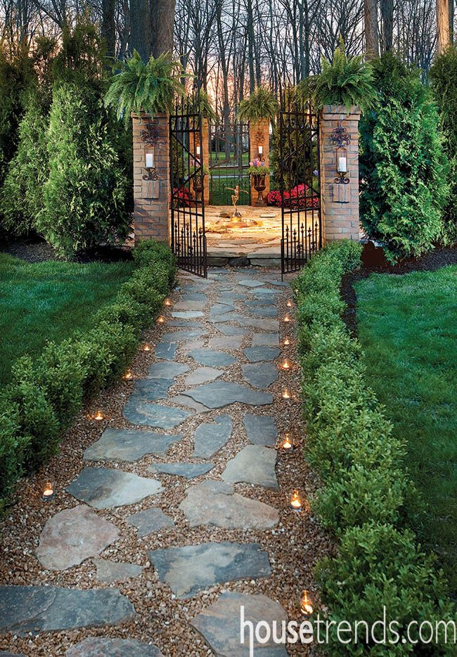 Boxwoods line a garden path design by Landfare, LTD