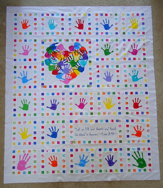 Possibility for donation quilt.  Small group include their hands - maybe write out prayers in a square next to their hand prints?