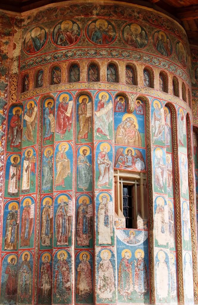 Beautiful frescoes painted on the outside of Voronet Monastery, Romania