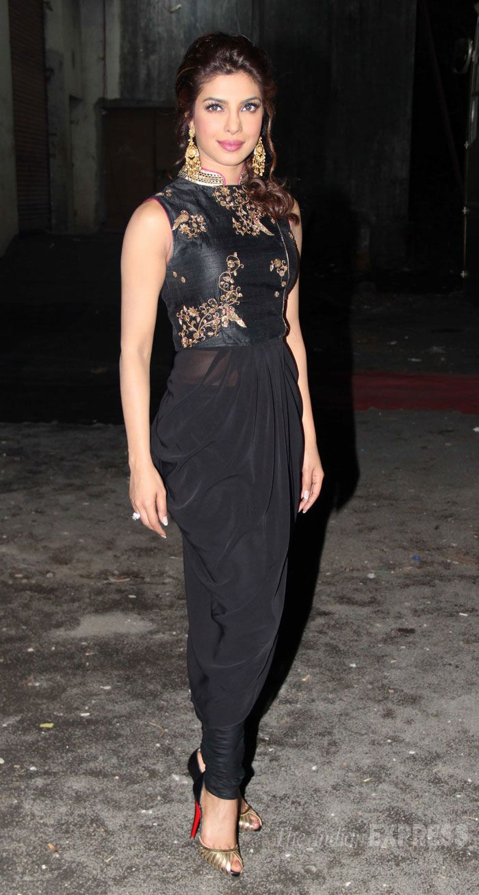 Priyanka Chopra was shining in black and gold Tisha Saksena draped churidar suit.