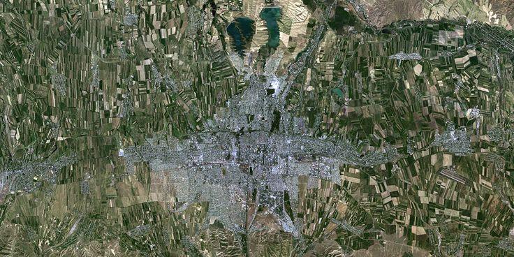 Bishkek, Kyrgyzstan - Great agricultural patterns around the city - PlanetSAT satellite image.