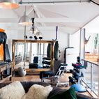 Weight machines mingle with modern art and well-worn couches in the lofted, open-plan living-and-gym area of a converted stable in London. A subtle balance emerges from the seemingly random mixture of equipment, art, and furniture; every item seems perfectly at home despite the lack of obvious organization. Photo byAndrea Bakacs.