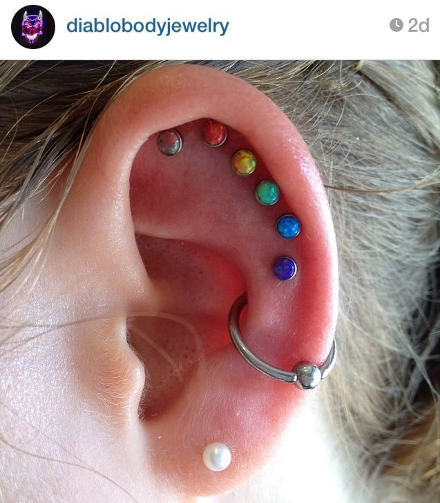 Done by the piercers at Diablo Rojo Piercing Neometal Colorful Opal Cabochons.