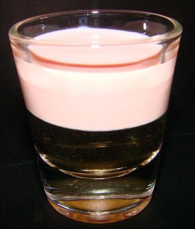 Pink Pussy Cat (Layered Shot) from Food.com:   								This is a very naughty drink. It tastes like strawberry ice cream chupa chups to me! (Lolly pops, not as popular in America as Australia and the UK. They are DELISH tho, even adults love them cause they taste like real ice cream and or fruit.) Be very careful gals and guys, cause they aren't very strong, but they go down VERY well. Quite sweet.
