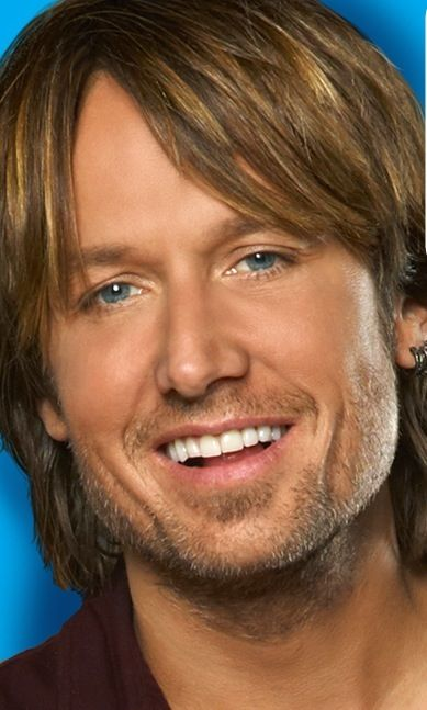 Keith Urban.  Oh my Gosh.   His voice, his hair, his style, his smile, and how nice he is is!!!