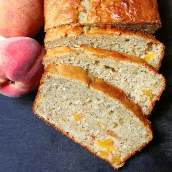 Ripe peaches and hearty oatmeal add flavor and texture to this moist and delicious gluten free bread. The floral aromas and honey-scented notes of a perfectly ripe peach are utterly intoxicating and well worth the wait all year long.