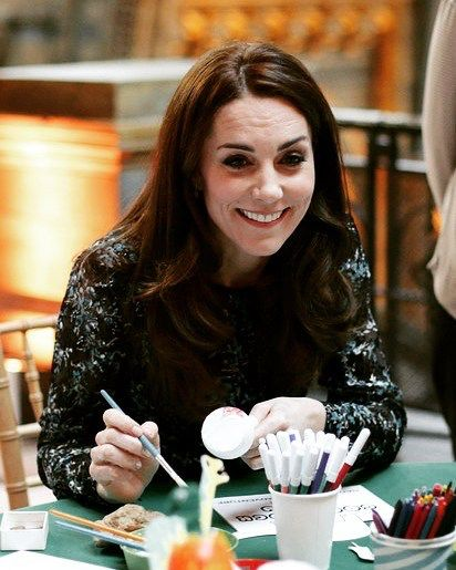 Catherine, Duchess of Cambridge makes a dinosaur egg whilst attending a children's tea party with pupils from Oakington Manor Primary School in Wembley, at the Natural History Museum to celebrate Dippy the Diplodocus's time in Hintze Hall on November 22, 2016 in London, United Kingdom. #katemiddleton #catherinemiddleton #duchessofcambridge