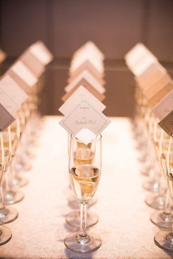 Innovative Escort Cards - The Top Wedding Trends for 2017 - Southernliving. Upgrade your escort cards by presenting them in an interesting way, like in a glass of champagne.