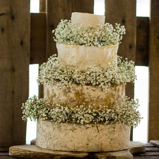Minnie Cheese Wedding Cake - A four-tier cake, with a delicious balance of tangy Cheddar, a classic Stilton, and two rich and delicate soft cheeses.