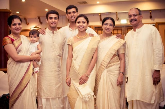 Family and friends in elegant cream and gold at a #kerala themed engagement ceremony :) More here: http://blackbookfortheindianbride.com/twinkle-weds-tittu-a-naval-themed-syrian-catholic-wedding/