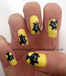yellow cat nail art