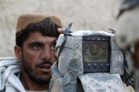 The 82nd in Afghanistan -- A U.S. Army soldier from 4-73 Cavalry Regiment, 82nd Airborne Division carries out an identification check on an Afghan man with a biometric device during a mission in Zhary district of Kandahar province, southern Afghanistan, April 18, 2012.   REUTERS/Baz Ratner