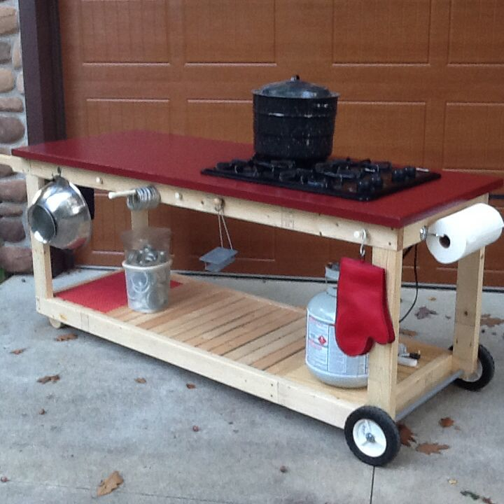 Canning bench made from an old door with a propane cooktop!