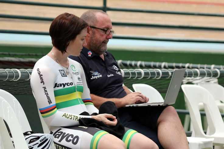 Anna discusses strategy with her coach.  Photo by Mal Matthews