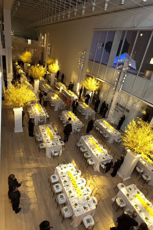 Bold yellow formal dinner with large florals on pedestals  Art Institute of Chicago