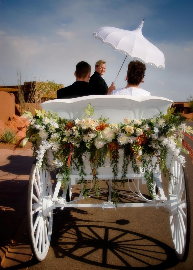 """Angeli Carriages - Our white folding top and Cinderella """"pumpkin"""" top can be removed and flowers added for this dramatic yet understated effect!   WWW.acarriage.com"""