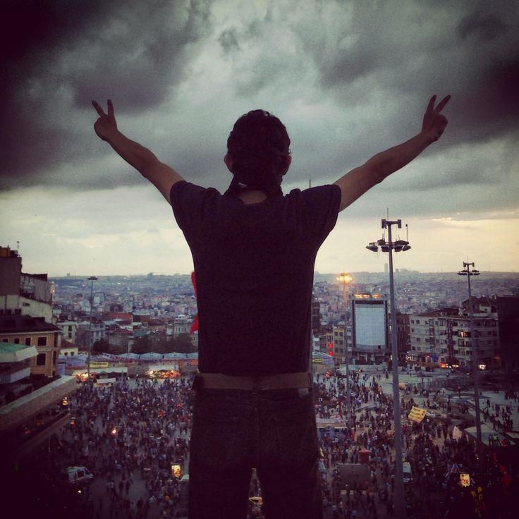 A protester on top of Ataturk Cultural Center overlooking Taksim Square yesterday. #occupyturkey #direngezi #civilresistance #turkey #geziparki