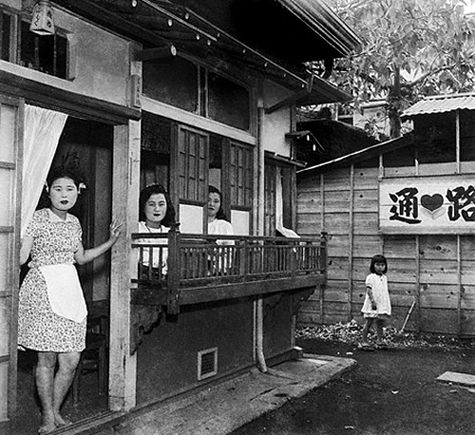 Prostitutes in Japan wait for clients (1947)