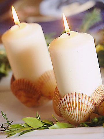 Make a fun candle holder with shells for a summer decorating.   BHG