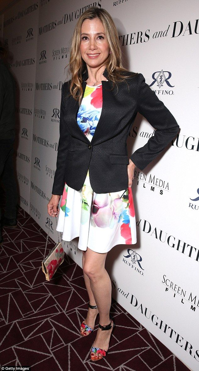 Flower power: Mira Sorvino, 48, was picture perfect in a matching ensemble of frock, sanda...