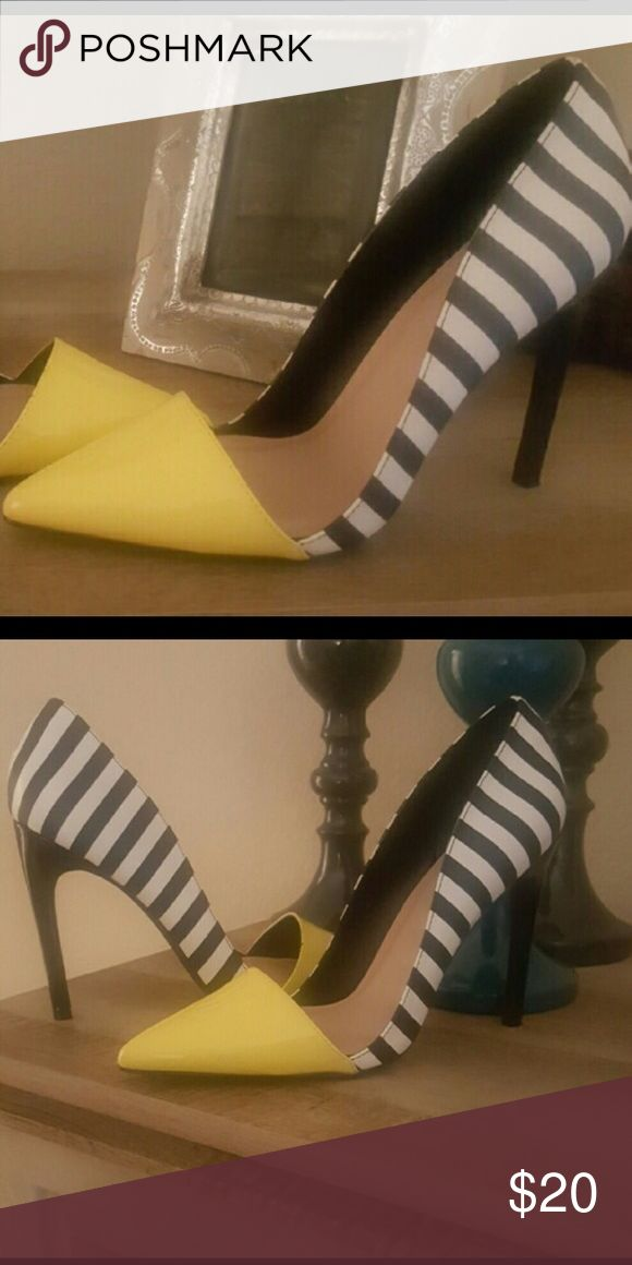 Stylish brand new yellow n zebra heels Never used brand new.4 inches heels JustFab Shoes Heels
