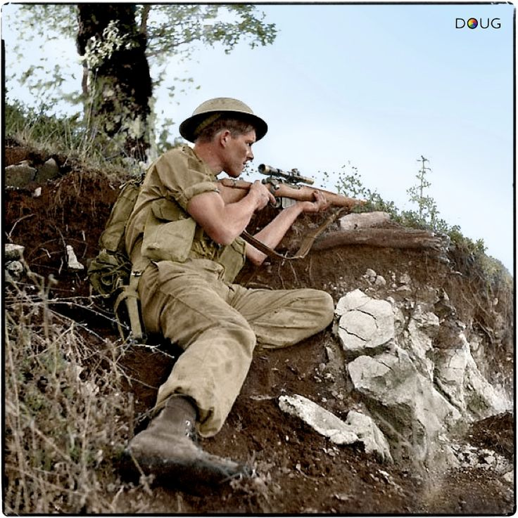 Private J.E. McPhee of The Seaforth Highlanders of Canada, armed with a Lee Enfield No. 4 Mk 1(T) sniper rifle, comes under German mortar fire at Foiano di Val Fortore, Italy, on 6 October 1943.