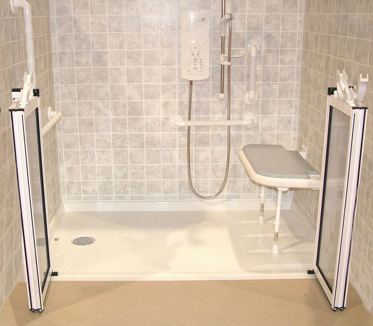 accessible shower accessories fold down seat grab bar and hand held shower