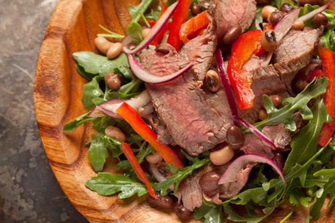 Flank Steak and Arugula Salad: Hearty yet healthy, this steak salad has black beans, black-eyed peas, red onions, and sweet bell peppers.
