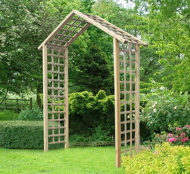 Manufactured from pressure treated smooth planed timber this popular timber garden arch features quality trellis panel walls and roof to provide good anchoring for climbing plants.