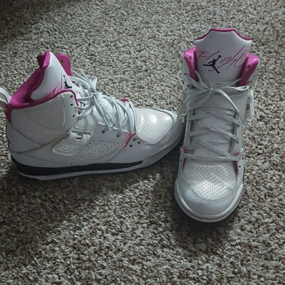 Air Jordan Pink, black white and silver lightly used Air Jordans. Little creasing. Couple scuffs but mostly in awesome condition. Youth 4.5 Jordan Shoes Sneakers