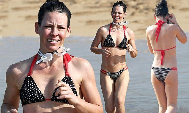 The Lost star, 37, displayed her rock hard abs and enviably slender figure in a skimpy patterned bikini as she enjoyed a sun-soaked run on the beach in Kauai.