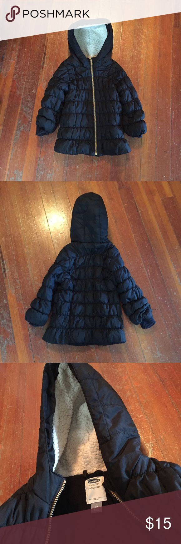 Toddler Winter Puffer Jacket This is a classic thin puffer jacket in black with white w/lined hood by old navy. It's is still in great shape and shows no signs of wear. Old Navy Jackets & Coats Puffers