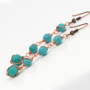 Add a touch of the exotic to your ensemble with these striking Turquoise semi-precious gemstone earrings.  Four eye-catching blue turquoise gemstone beads (6mm & 8mm) are wrapped by hand with pure copper wire and set on a bronze ear wire.