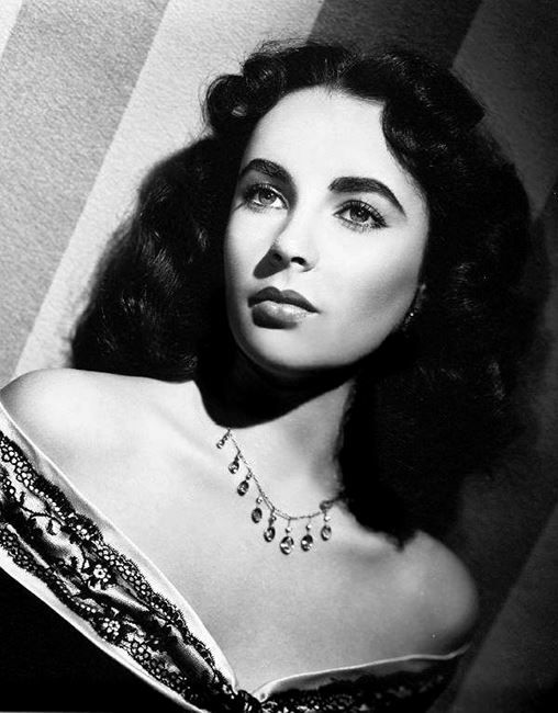 """Elizabeth Taylor in a publicity still for the MGM film, """"Julia Misbehaves"""" (1948)"""