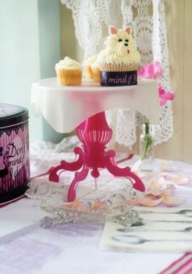 Peggy Cake Stand £23.00    Wonderfully easy to assemble in a matter of moments and available in a vibrant pink, blue or green.     The cake tier is separate from the stand so it easily slots into your cake tin to provide a much-needed extra shelf – Those beautifully decorated cakes and muffins will never be flattened again.      Simply lift the shelf straight out of the tin and slot the pedestals into the tier notches and hey presto… a delightful cake stand, ready to go.
