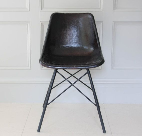 This Antique Black leather road house chair is a great combination of the Eames chair and the road house given a very modern fell at the same time