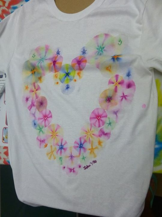 """Groovy Sharpie Tie-Dye t-shirts created by teens at the """"Peace, Love, Music, Tie-Dye"""" program at the Temecula Public Library during the Read to the Rhythm Summer Reading Program 2015."""