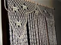 Handmade macrame curtain.