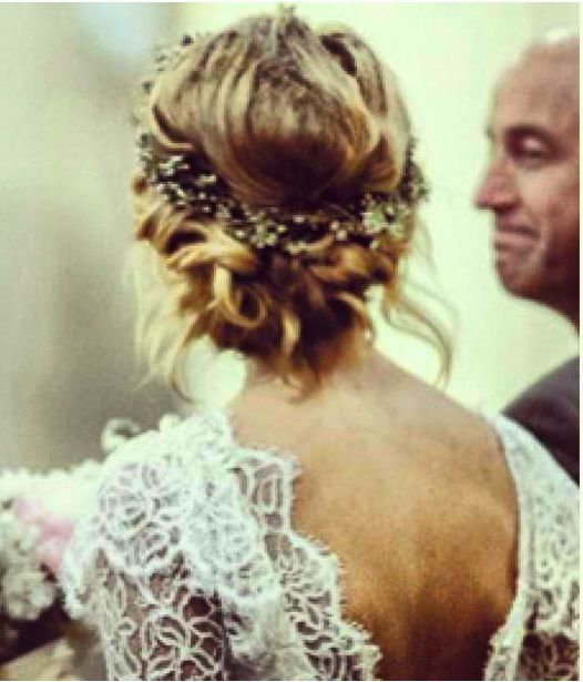 the man in the background makes this picture slightly awkward... but i love her loose braid and lace